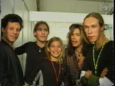 The Hanson brothers meeting Steven Tyler. Jon Bon Jovi can be seen to the right